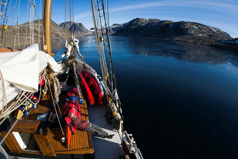 Relaxing on the schooner surrounded by the mountains and the ...