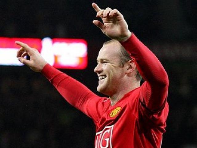 Wayne Rooney fagnar marki.