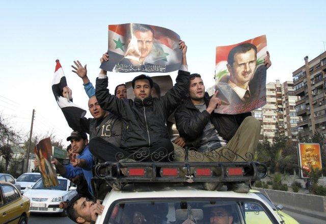 Stuðningsmenn Bashar al-Assad forseta í Damaskus.