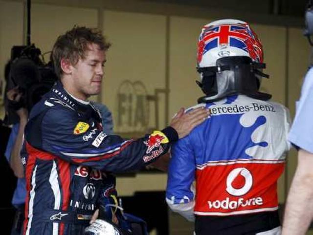 Button og Vettel takast í hendur í Montreal.