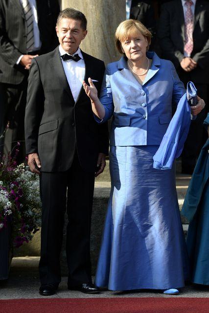 Angela Merkel og eiginmaður hennar Joachim Sauer mæta á Bayreuth ...