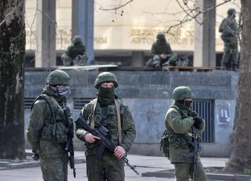 Armed men in front of the Crimean Parliament in March ...
