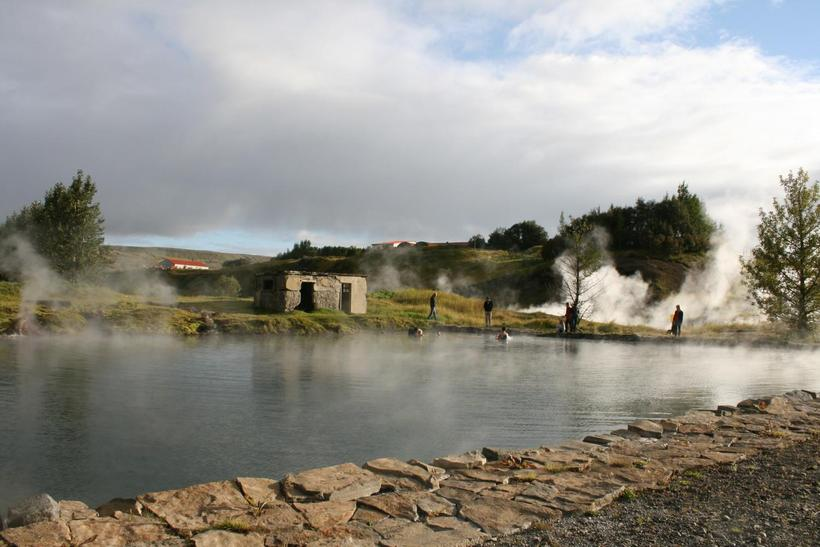 The Secret Lagoon is a natural geothermal pool. The surroundings ...