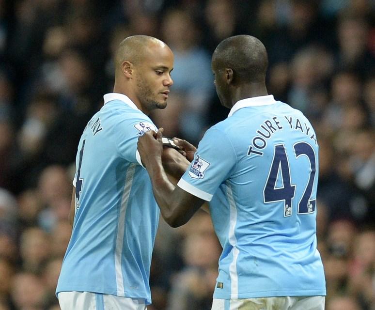 Vincent Kompany og Yaya Toure samherji hans hjá Manchester City.