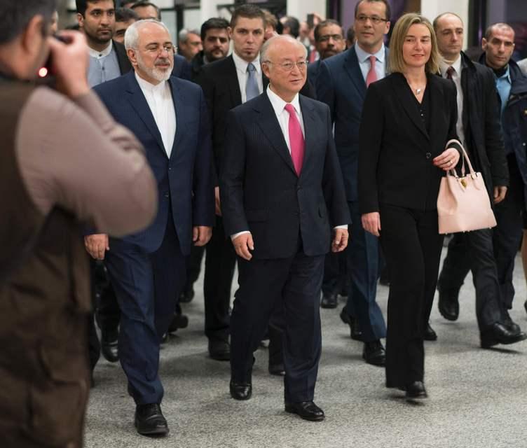 IAEA chief Yukiya Amano (middle), Iranian Foreign Minister Mohammad Javad ...