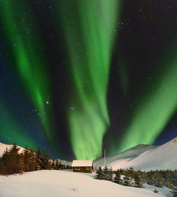 The Northern Lights over Skarðsdalur valley in Siglufjörður, North Iceland.