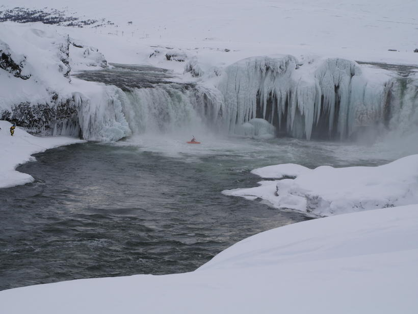 The exhilerating descent of the partly frozen Goðafoss waterfall.