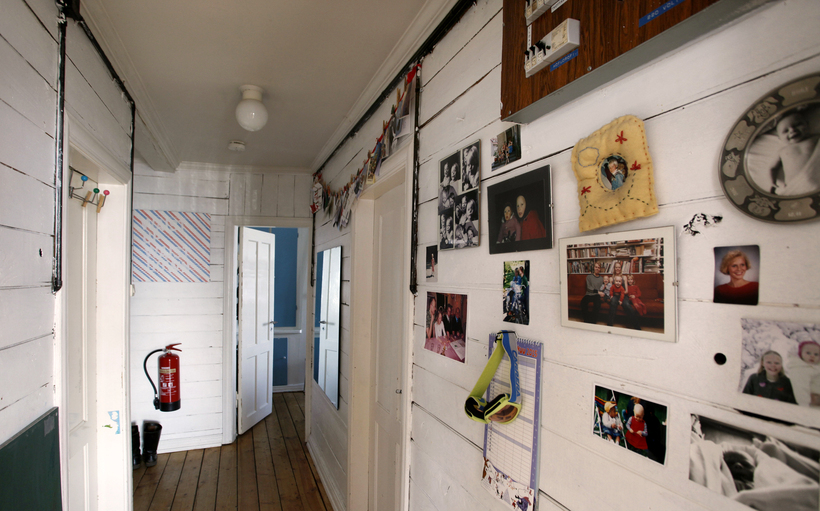 Photographs are used to decorate the hallway.