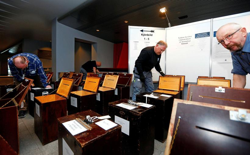 Employees at the City Hall in Reykjavik preparing the election ...