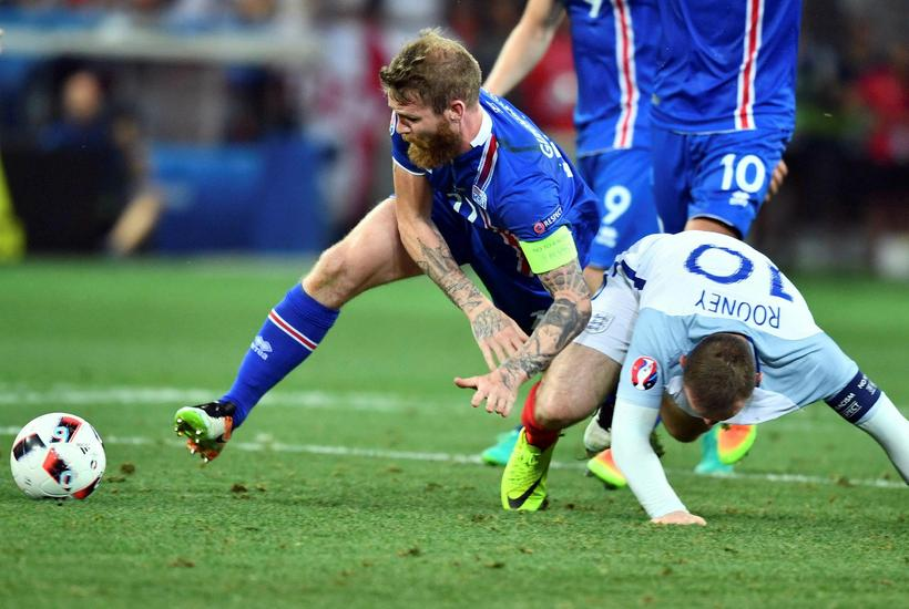 Iceland's Aron Einar Gunnarsson and England's Wayne Rooney battling it ...
