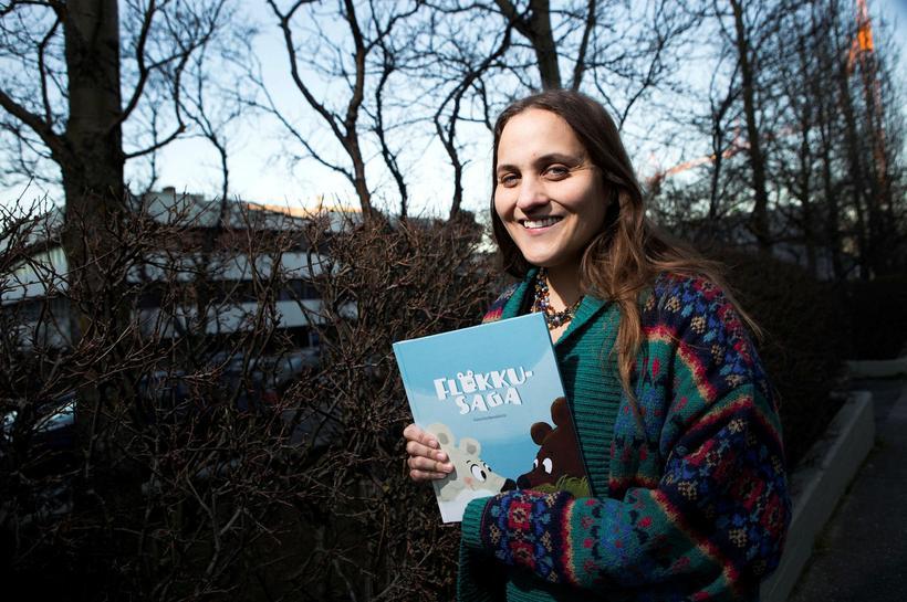 Author Lára Garðarsdóttir with her book, titled Bear with me ...