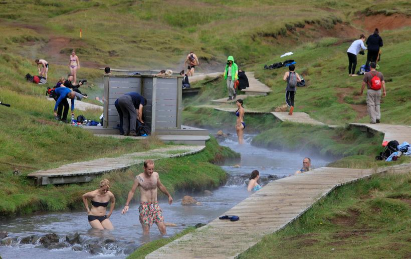 Tourists bathing in the geothermal stream at Reykjadalur.