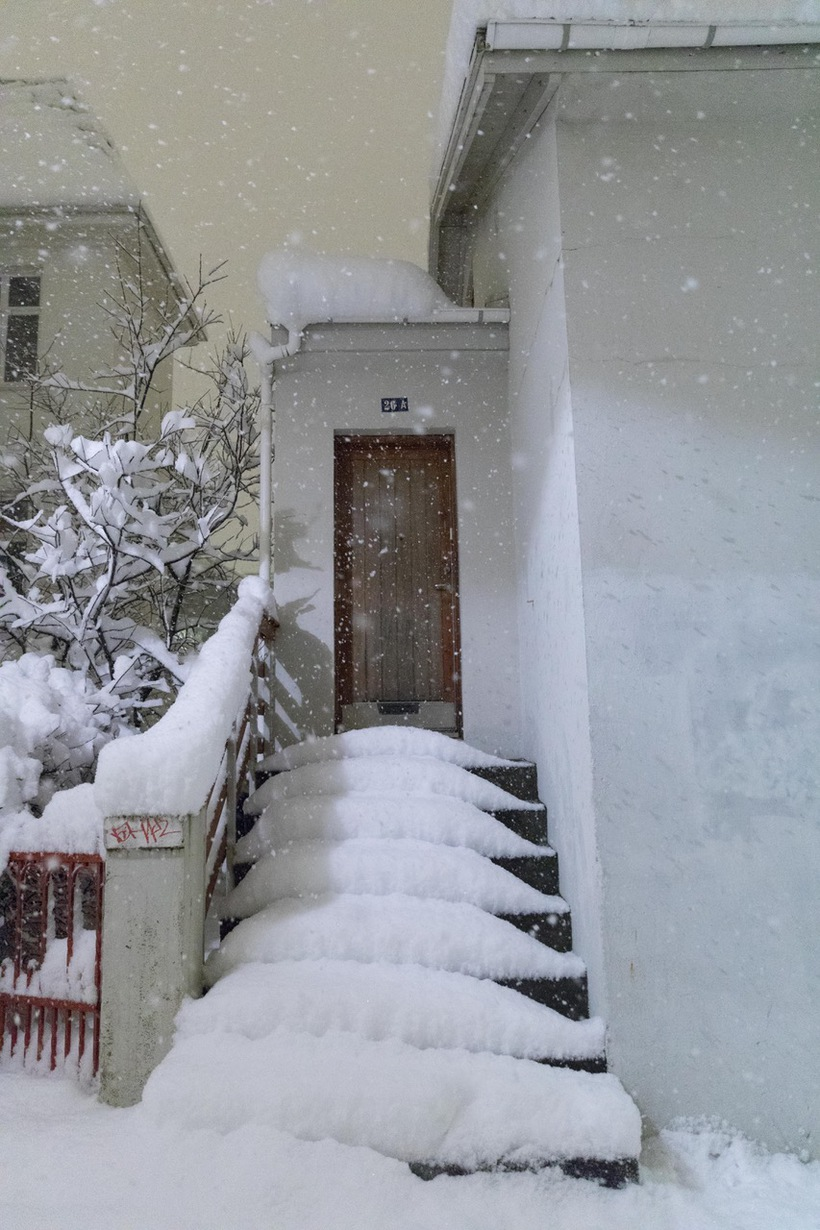 Snowed up stairs on a Reykjavik residence.