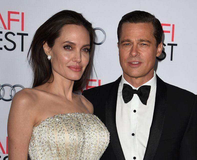 Angelina Jolie Pitt og Brad Pitt árið 2015 eða um ...