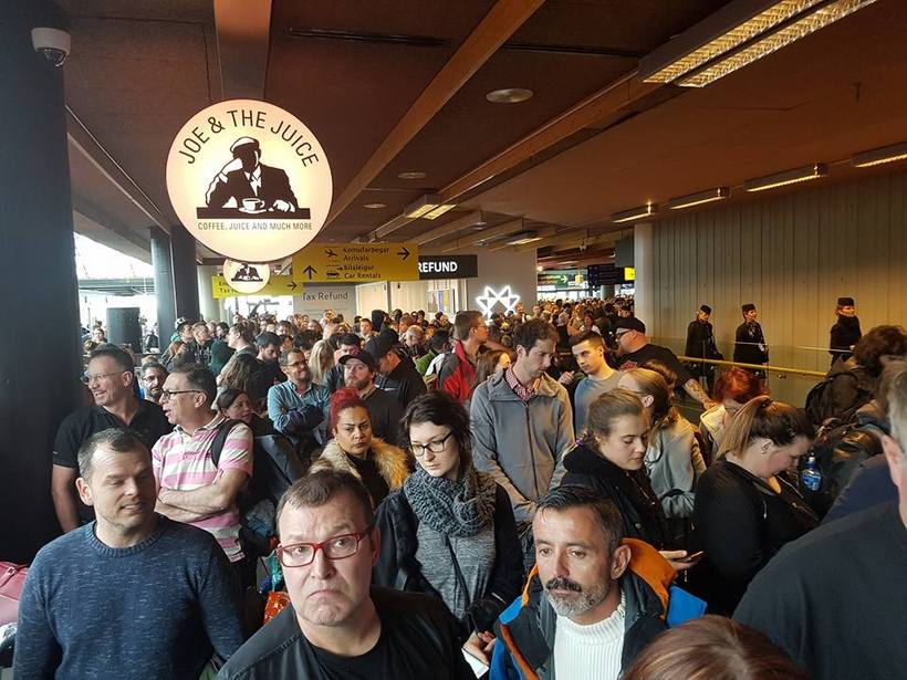 The check in area was packed with people waiting to ...
