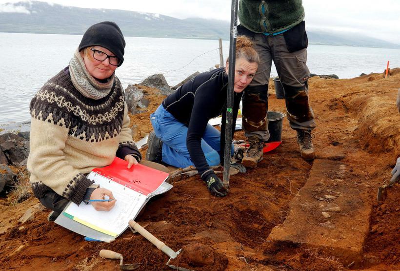 Archaeologist Hildur Gestsdóttir and head of the excavation, along with ...
