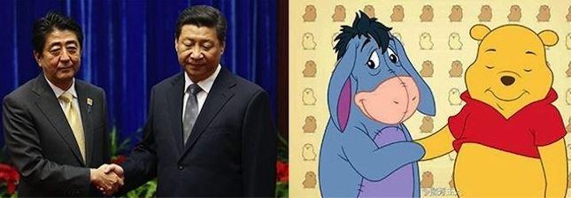 Xi og Shinzo Abe, forsætisráðherra Japans, heilsast og sama gera ...