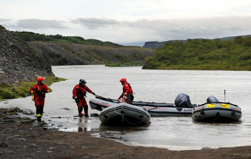 Search and rescue teams near the area where the body ...