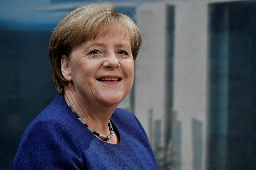 """Samkvæmt skýrsluhöfundum fjölluðu fjölmiðlar ekki um """"allir velkomnir""""-stefnu Angelu Merkel ..."""