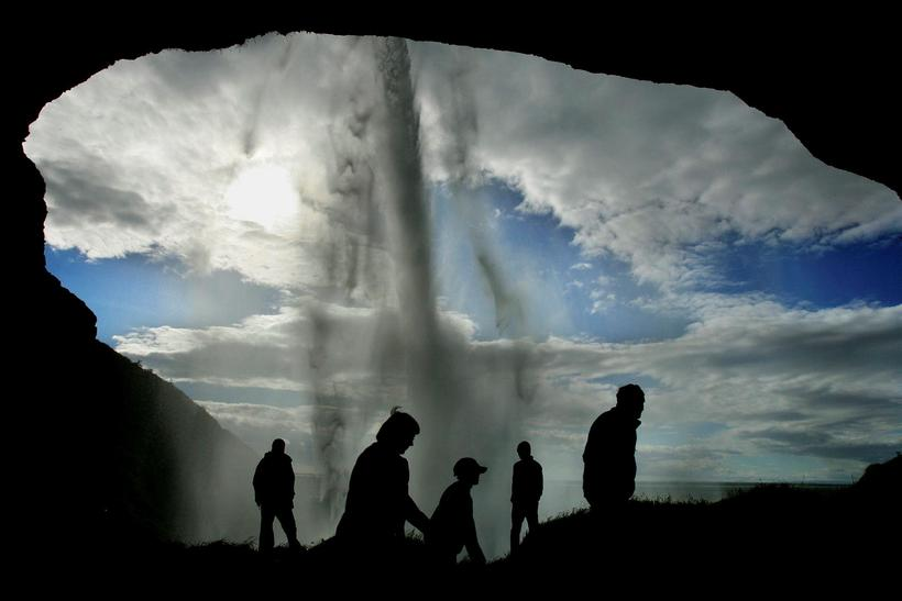 People are able once again to walk behind the waterfall.