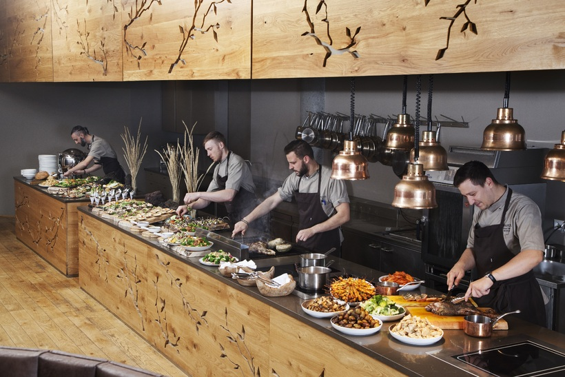 Chefs preparing the dinner buffet at Haust.
