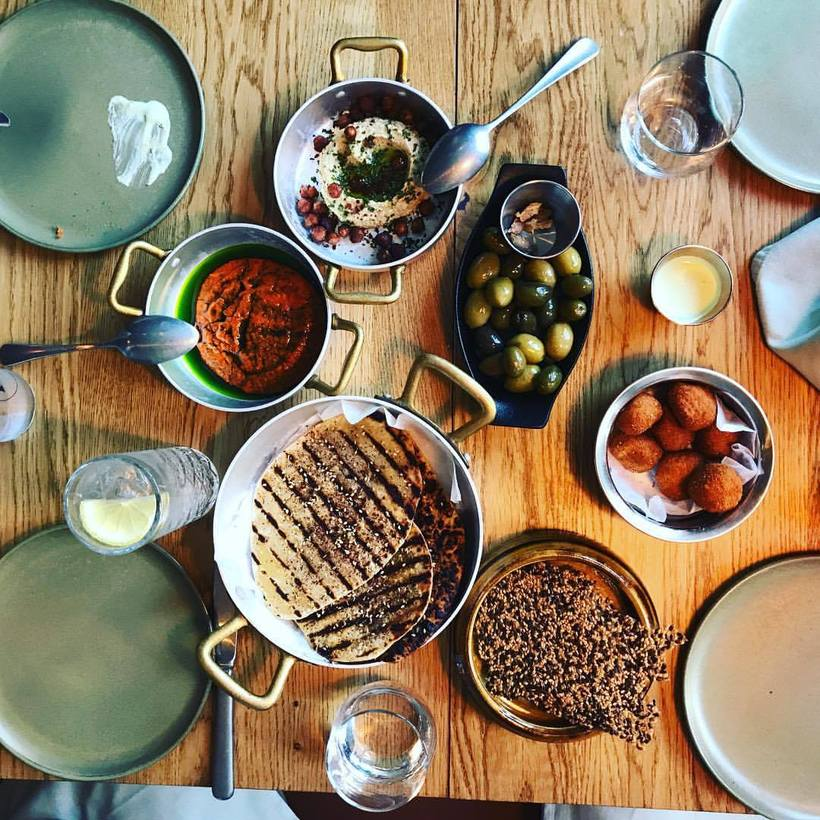 A selection of traditional meze at Sumac: flatbread, hummus, olives, ...