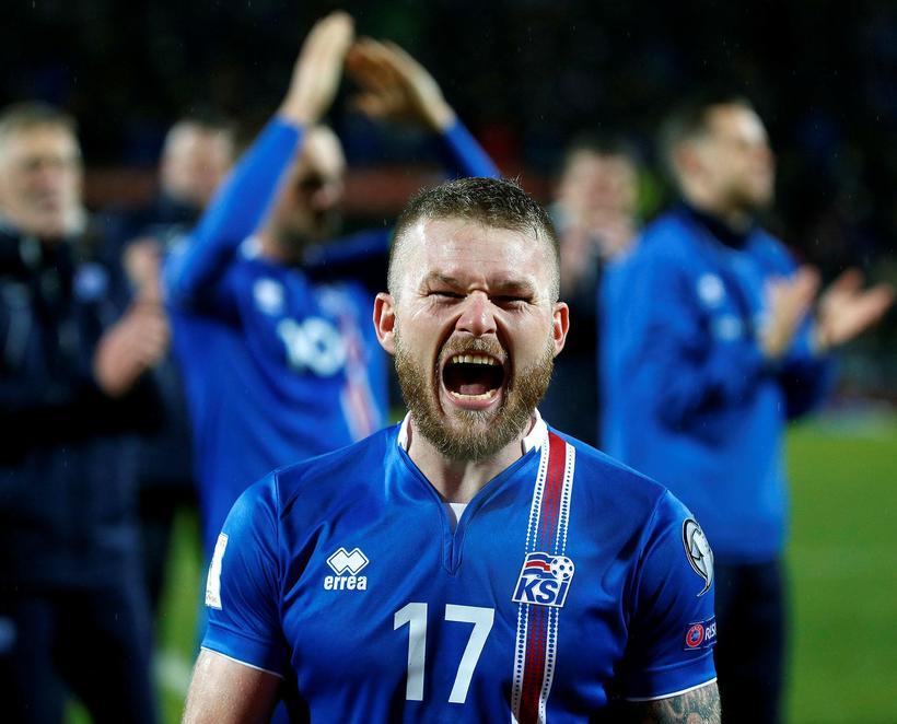 Aron Einar shouting with joy.