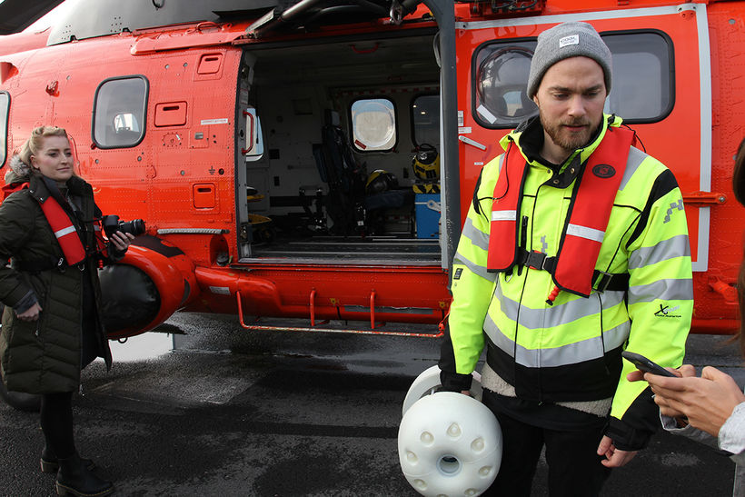 Ásgeir Trausti with the bottle, getting ready to board the …