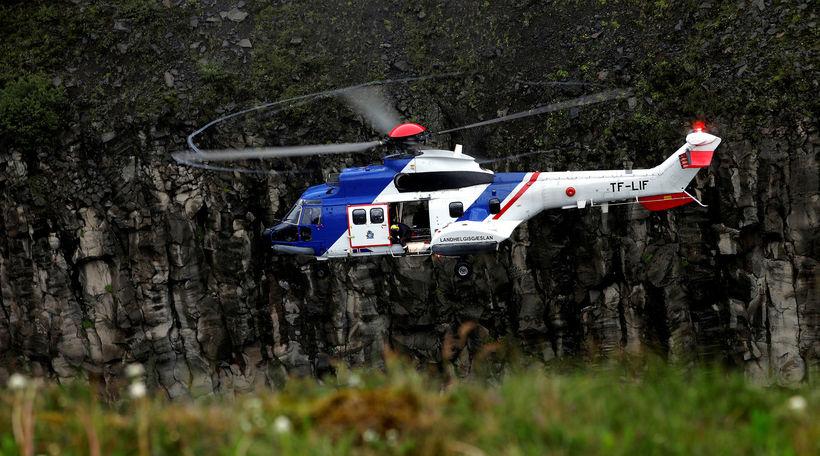 TF-LIF sótti sjúkling til Vestmannaeyja í dag í miklu hvassviðri.
