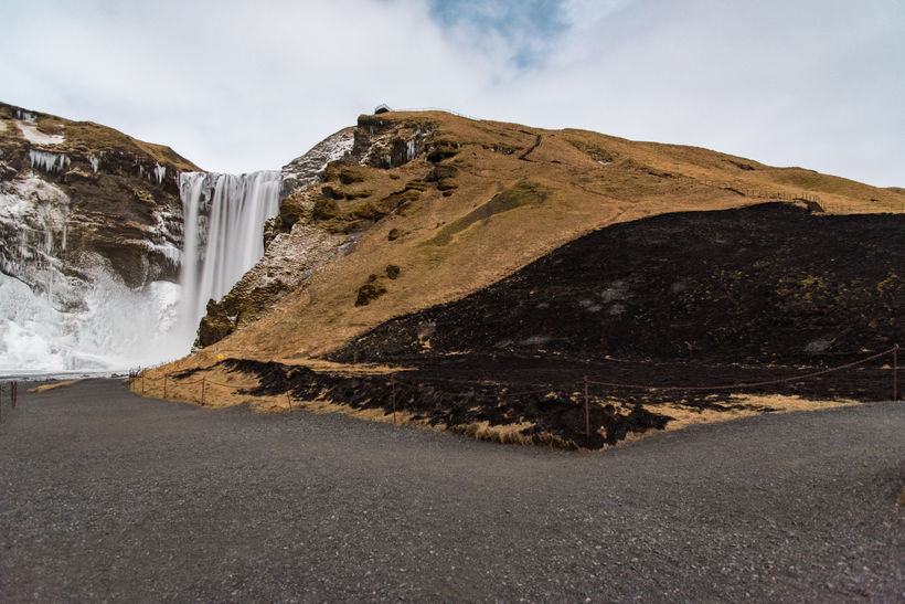 The burned dried grass at Skógafoss visible here on the ...