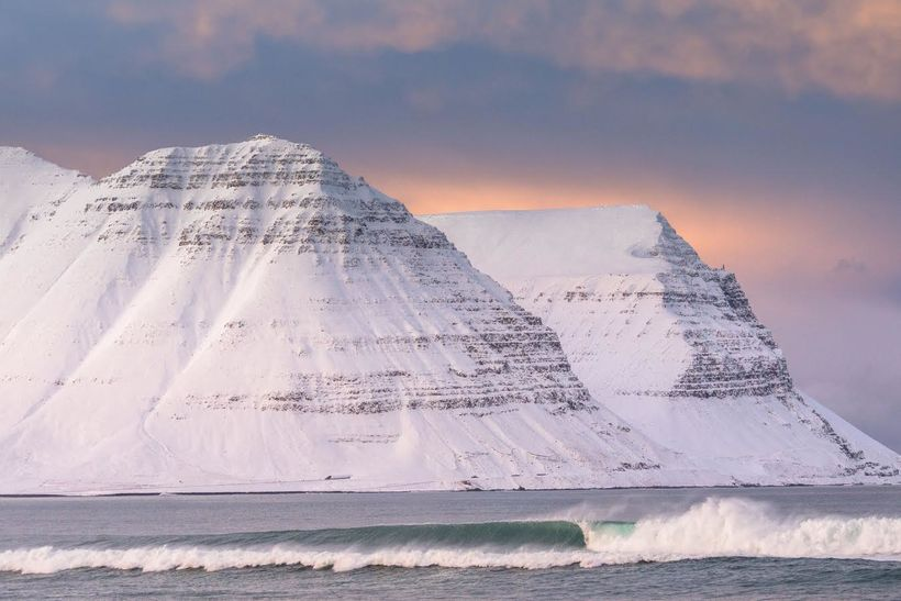 Surfing the remote West Fjords of Iceland beneath the