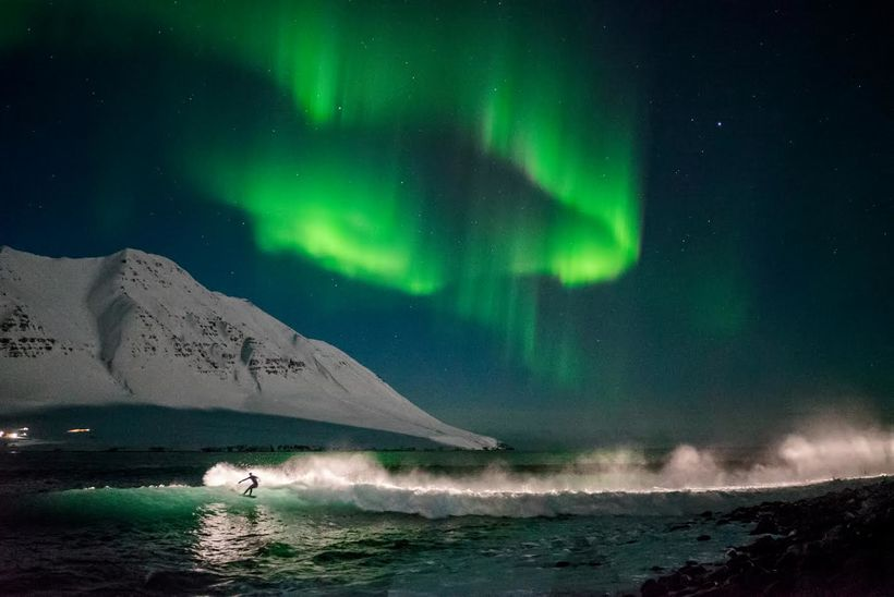 Surfing deep in the West Fjords of Iceland.