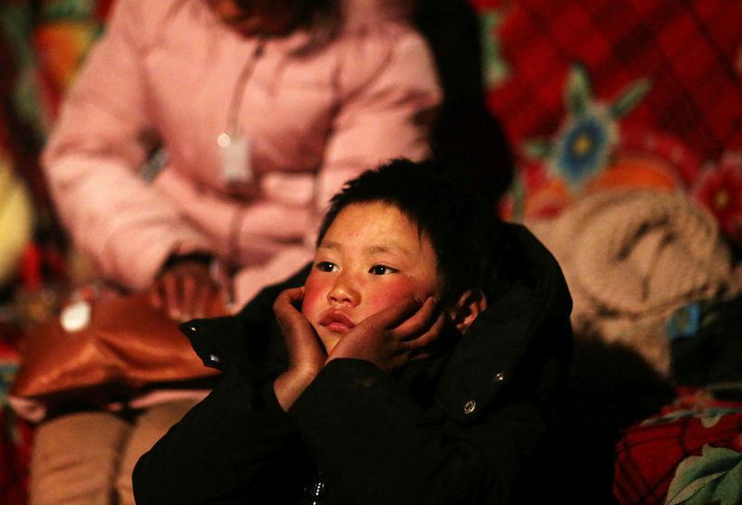 Tugmilljónir fátækra barna í Kína hafa verið skildar eftir af ...