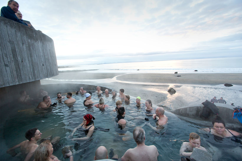 The firsts guests at Guðlaug pool enjoying the warm waters.