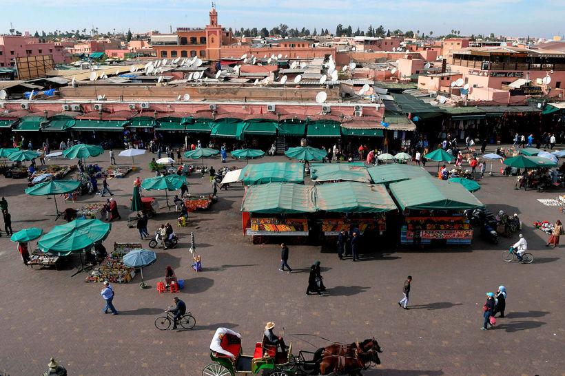 Markaðstorg í borginni Marrakesh í Marokkó.