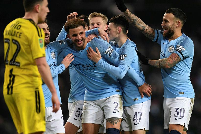 Manchester City fagnar einu af níu mörkum sínum gegn Burton.