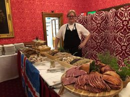 Garðar in front of his Þorri buffet at the House of Lords.