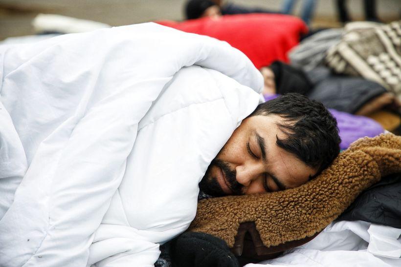 A man sleeping outside on Austurvöllur.