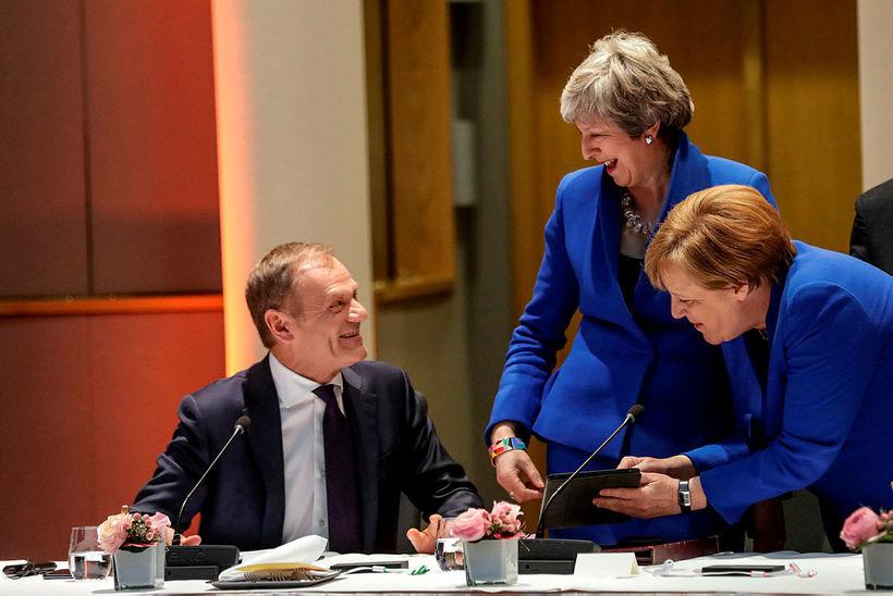 Donald Tusk, Theresa May og Angela Merkel á fundi leiðtoga ...