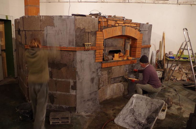 The oven being built.