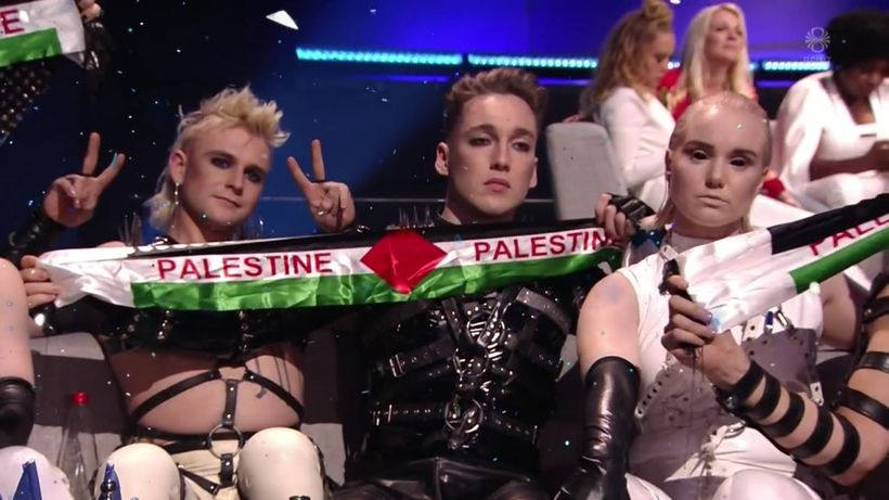 Hatari band members, waving a banner in the colors of ...