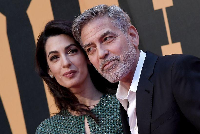 Clooney ásamt eiginkonu sinni, lögrfæðingnum Amal.