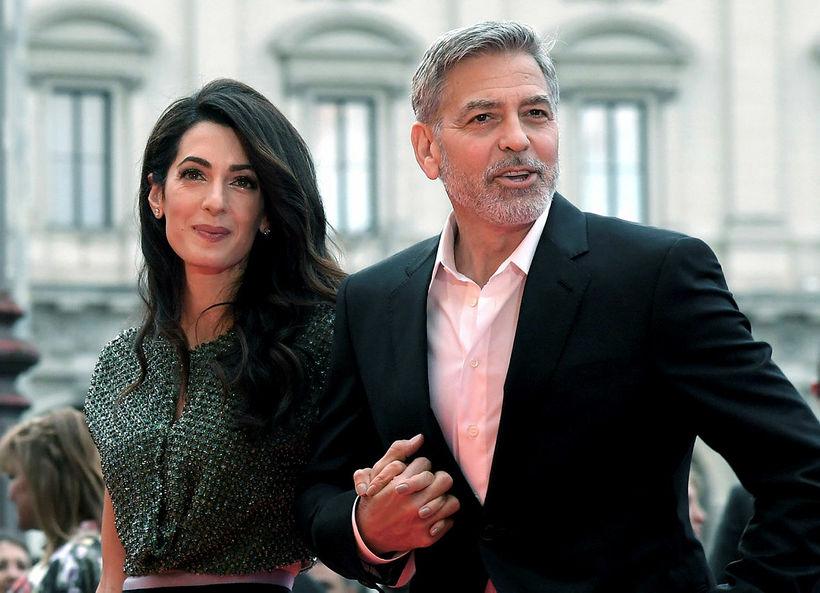 Amal og George Clooney eiga saman tvíbura sem eru að ...