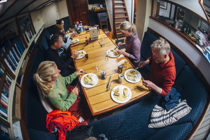 Enjoying dinner on board the sailboat.