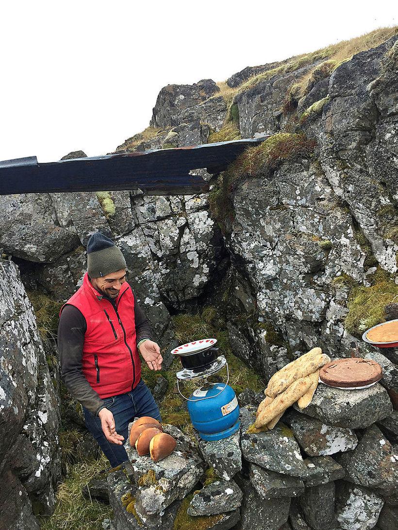 Thomas bakes outdoors.