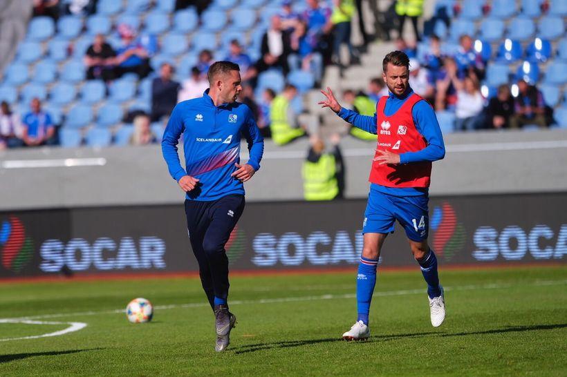 Gylfi Þór Sigurðsson and Kári Árnason, during the warmup.