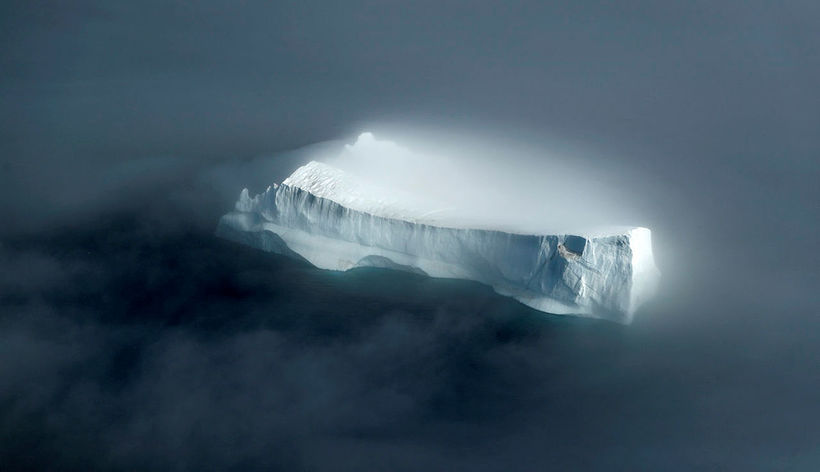 The majestic iceberg, looking mysterious in the fog. It is ...