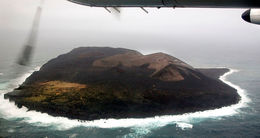 Surtsey island. The assistants will take pictures from the air.