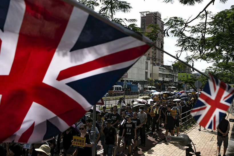 British flags flutter as protesters march at an anti-parallel trading ...