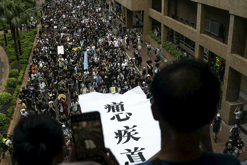TOPSHOT - Protesters attend a rally against a controversial extradition ...